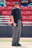 Home plate umpire Blake Selter prior to the start of the South Atlantic League game between the Greensboro Grasshoppers and the Hickory Crawdads at  L.P. Frans Stadium July 10, 2010, in Hickory, North Carolina.  Photo by Brian Westerholt / Four Seam Images