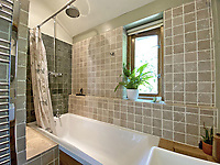 BNPS.co.uk (01202) 558833. <br /> Pic: LillicrapChilcott/BNPS<br /> <br /> Pictured: Bathroom. <br /> <br /> A pretty wooden cottage with spectacular panoramic sea views is on the market for £595,000.<br /> <br /> The aptly-named The Hut is an eco-built property set on a hill in the hugely sought-after Cornish village of Mousehole.<br /> <br /> The small but perfectly-formed home looks down over Mousehole harbour and across Mounts Bay to St Michael's Mount.