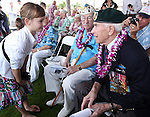 Gabi Shultz, 10, talks with Pearl Harbor survivors Ab Brum and Sam Clower before the 71st Anniversary Pearl Harbor Day Commemoration at the Pearl Harbor Visitor Center in Honolulu, HI on, Dec. 7, 2012. .Photo by Cathleen Allison