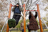 Members of an over-50s walking group use new equipment on a Fitness Trail installed by Westminster City Council at Westbourne Green, Paddington.