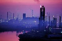 Smog shrouds a Houston oil refinery, Houston, Texas