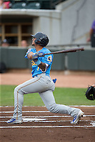 Gleyber Torres (11) of the Myrtle Beach Pelicans follows through on a solo home run in the top of the first inning against the Winston-Salem Dash at BB&T Ballpark on April 19, 2016 in Winston-Salem, North Carolina.  The Dash defeated the Pelicans 6-5.  (Brian Westerholt/Four Seam Images)