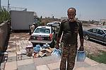 21/07/14  Iraq -- Daquq, Iraq -- A Peshemrga brings water bottles donated by local population at the base in Daquq.