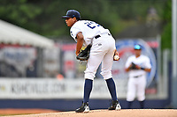 Asheville Tourists starting pitcher Erick Julio (29) looks in for the signals during a game against the Lexington Legends at McCormick Field on May 29, 2017 in Asheville, North Carolina. The Legends defeated the Tourists 6-2. (Tony Farlow/Four Seam Images)