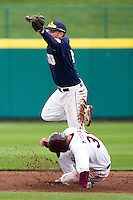 Spencer Barnett (2) of the Oral Roberts Golden Eagles catches a high thrown ball as Travis McComack (31) of Missouri State slides into second during a game against the Missouri State Bears on March 27, 2011 at Hammons Field in Springfield, Missouri.  Photo By David Welker/Four Seam Images