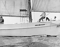 """Chesapeake Bay workboat Rosie Parks' crew enjoy her turn of speed as she slips through the glistening bay waters, unmatched in beauty or speed, and sails to victory in the 1967 Deal Island Skipjack race. Photograph from the restored Limited Edition Skipjack print in the Fine Art """"Skipjack Sunday"""" collection."""