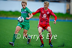 Ronan Teahan of Kerry and Cork City's Mark O'Mahony tussle for possession in the U17 Mark Farran Cup