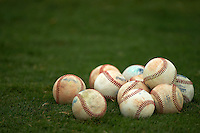 Baseballs on the grass during practice before an instructional league game between the San Diego Padres and Milwaukee Brewers on October 6, 2015 at the Peoria Sports Complex in Peoria, Arizona.  (Mike Janes/Four Seam Images)
