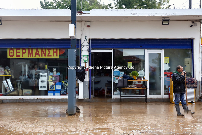 A shop owner stands outside his property in Nea Mihaniona