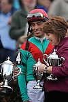 Jockey John Velazquez gets the hardware after his win on Went The Day Well in the G3 Vinery Spiral Stakes at Turfway Park in Florence, Kentucky Saturday March 24, 2012.