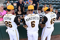 Jacksonville Suns Reid Redman (26), Jheyson Manzueta (6), and Blake Logan (45) sign autographs before game three of the Southern League Championship Series against the Chattanooga Lookouts on September 12, 2014 at Bragan Field in Jacksonville, Florida.  Jacksonville defeated Chattanooga 6-1 to sweep three games to none.  (Mike Janes/Four Seam Images)
