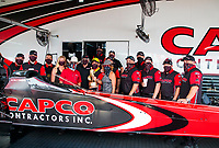 Jul 12, 2020; Clermont, Indiana, USA; NHRA top fuel driver Billy Torrence celebrates with crew after winning the E3 Spark Plugs Nationals at Lucas Oil Raceway. This is the first race back for NHRA since the start of the COVID-19 global pandemic. Mandatory Credit: Mark J. Rebilas-USA TODAY Sports