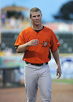 Pitcher Dylan Bundy (6) of the Frederick Keys walks in from the clubhouse during a game against the Myrtle Beach Pelicans on August 4, 2012, at TicketReturn.Com Field in Myrtle Beach, South Carolina. Myrtle Beach won, 4-3. Bundy is the Baltimore Orioles' No. 1 prospect, according to Baseball America. (Tom Priddy/Four Seam Images)