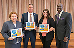 Agnes Perry, David Muzyka, Keri Fovargue and Ken Huewitt pose for a photograph after Children at Risk presented awards to area schools at Pilgrim Academy, June 6, 2016.