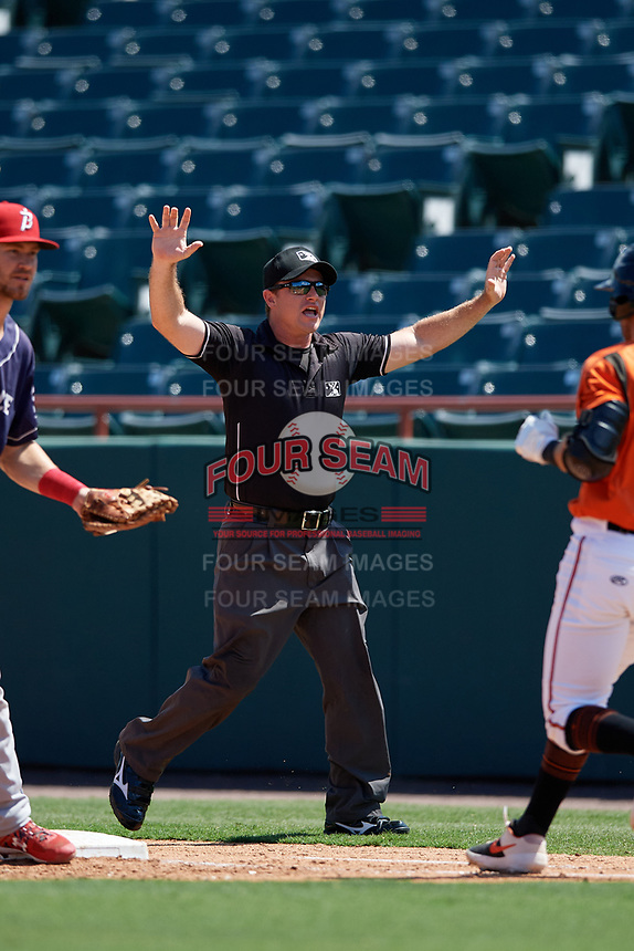 Umpire Tom West calls a foul ball during an Eastern League game between the Binghamton Rumble Ponies and Bowie Baysox on August 21, 2019 at Prince George's Stadium in Bowie, Maryland.  Bowie defeated Binghamton 7-6 in ten innings.  (Mike Janes/Four Seam Images)