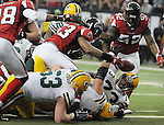 Atlanta Falcons' Mike Peterson, center, grabs a fumble Green Bay Packers quarterback Aaron Rodgers near the end zone during the second quarter of the game at the Georgia Dome in Atlanta, Ga., on Nov. 28, 2010.  Packers Scott Wells, bottom left, Josh Sitton and Daryn Colledge also go for the ball.