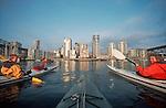 Vancouver, British Columbia Canada, women Sea Kayakers, paddling False Creek, West End neighborhood in the distance
