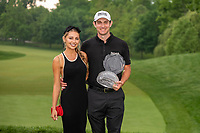 6th June 2021; Dublin, Ohio, USA;Patrick Cantlay (USA) holds the trophy with his girlfriend Nikki Guidish after winning the sudden death playoff of the Memorial Tournament at Muirfield Village Golf Club in Dublin, Ohio