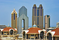 Al  Murooj Rotana Hotel  apartments,  arch of Dusit Thani hotel and tall buildings on Sheikh Zayed Road.   Dubai. United Arab Emirates.