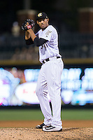 Charlotte Knights relief pitcher Michael Ynoa (38) looks to his catcher for the sign against the Syracuse Chiefs at BB&T BallPark on June 1, 2016 in Charlotte, North Carolina.  The Knights defeated the Chiefs 5-3.  (Brian Westerholt/Four Seam Images)