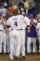 LSU Tigers outfielder Raph Rhymes #4 is greeted at home after hitting a three run home run in the first inning against the Auburn Tigers in the NCAA baseball game on March 22nd, 2013 at Alex Box Stadium in Baton Rouge, Louisiana. LSU defeated Auburn 9-4. (Andrew Woolley/Four Seam Images).