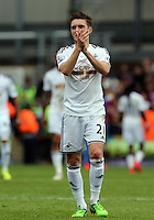 Pictured: Matt Grimes of Swansea thanks away supporters<br />