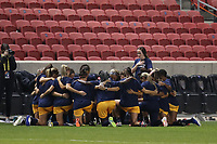 SANDY, UT - OCTOBER 03: Utah Royals FC players huddle and knee during the Nation Anthem before a game between Portland Thorns FC and Utah Royals FC at Rio Tinto Stadium on October 03, 2020 in Sandy, Utah.
