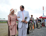 Marylou Whitney in the winner's circle with her husband John Hendrickson on Whitney Handicap Day at Saratoga Race Course in Saratoga Springs, New York on August 4, 2012
