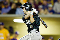 Mark Rhine #2 of the Wake Forest Demon Deacons follows through on his swing against the LSU Tigers at Alex Box Stadium on February 18, 2011 in Baton Rouge, Louisiana.  The Tigers defeated the Demon Deacons 15-4.  Photo by Brian Westerholt / Four Seam Images