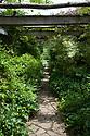 Oak-beamed Pergola, looking towards the pond, Vann House and Garden, Surrey, mid June.