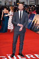 "Glen Powell<br /> arriving for the world premiere of ""The Guernsey Literary and Potato Peel Pie Society"" at the Curzon Mayfair, London<br /> <br /> ©Ash Knotek  D3394  09/04/2018"