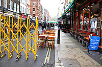 Struggling bars and restaurants in London will be at a crossroads at the end of this week. It's a few days before the end of the programme of road closures in Soho and Covent Garden that has permitted restaurants and bars to put tables in the streets for the first time.<br /> Soho was transformed into an alfresco dining district, but as winter is fast approaching, streets in the cold and rain are virtually empty and with the prospect of a further lockdown many businesses who have tried so hard to make it pay, look like being forced to close up - this time for good. London, Monday October 26th 2020<br /> <br /> Photo by Keith Mayhew