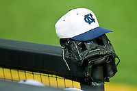 A North Carolina Tar Heel cap sits on top of a glove at Gene Hooks Field on March 11, 2011 in Winston-Salem, North Carolina.  Photo by Brian Westerholt / Four Seam Images
