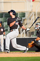 Jonathan Roof #3 of the Hickory Crawdads follows through on his swing after hitting a solo home run against the Kannapolis Intimidators at Fieldcrest Cannon Stadium on April 17, 2011 in Kannapolis, North Carolina.   Photo by Brian Westerholt / Four Seam Images