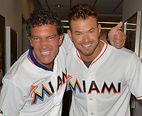 MIAMI, FL - AUGUST 13: Expendables 3 stars Antonio Banderas and Kellan Lutz throw out the first pitch at the St. Louis Cardinals vs. the Miami Marlins at Marlins Park on August 13, 2014 in Miami, Florida.