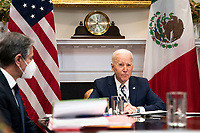 United States participates in a virtual bilateral meeting with President Andrés Manuel López Obrador of Mexico in the Roosevelt Room of the White House in Washington on March 1st, 2021.  At left is US Secretary of State Antony Blinken<br /> Credit: Anna Moneymaker / Pool via CNP /MediaPunch