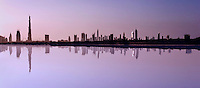 Dubai.  Skyline of the city, financial district and Downtown Development with Burj Dubai, photographed over the Creek Nature Reserve.  Digital composite..