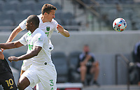 LOS ANGELES, CA - APRIL 17: Matt Besler #5 of Austin FC clears a ball during a game between Austin FC and Los Angeles FC at Banc of California Stadium on April 17, 2021 in Los Angeles, California.