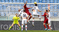 Roma's Gianluca Mancini, top left, heads the ball to score the winning goal during the Italian Serie A Football match between Roma and Genoa at Rome's Olympic stadium, March 7, 2021. Roma won 1-0.<br /> UPDATE IMAGES PRESS/Riccardo De Luca
