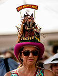 """SARATOGA SPRINGS, NY - AUGUST 25: A woman wears a decorative hat saying """"Wish You Were Here"""", with """"Justify"""" emblazoned on the brim on Travers Stakes Day at Saratoga Race Course on August 25, 2018 in Saratoga Springs, New York. (Photo by Carson Dennis/Eclipse Sportswire/Getty Images)"""