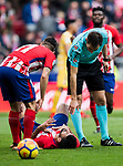 Referee Ricardo de Burgos Bengoechea speaks to Diego Costa of Atletico de Madrid who lies injured on the pitch during the La Liga 2017-18 match between Atletico de Madrid and Girona FC at Wanda Metropolitano on 20 January 2018 in Madrid, Spain. Photo by Diego Gonzalez / Power Sport Images