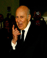 ARCHIVE: Carl Reiner responds to a reporter's question as he arrives for the eighth annual Mark Twain Prize for American Humor, which is being awarded this year to Steve Martin at the John F. Kennedy Center for the Performing Arts in Washington, D.C. on October 23, 2005.Credit: Ron Sachs/CNP/AdMedia