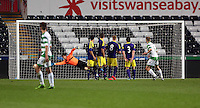 Thursday, 16 April 2014<br /> Pictured: Ryan Kershaw of TNS (R) scores the only goal for his team.<br /> Re: FAW Youth Cup Final, Swansea City FC v The New Saints FC at the Liberty Stadium, south Wales,