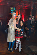 Dancers in costume at a Halloween party.