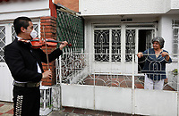 BOGOTA, COLOMBIA - MAY 20: A musician dressed as a traditional Mexican singer knows as Mariachi, performs for free looking for some future clients on May 20, 2020 in Bogota, Colombia. Colombian President Ivan Duque extended COVID-19 lockdown until May 31. He also anticipated that   several economic activities and industries will start reopening from June 1, following health protocols and restrictions. (Photo by John Vizcaino/VIEWpress)