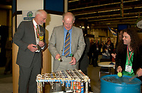 March 19 2003, Montreal, Quebec, Canada<br /> <br /> <br /> David Anderson,Canada's  Environment Minister (L) and Andre Caille, President and CEO of Hydro Quebec and Honorary President of AMERICANA 2003 (R) ,join the SCRAP BAND  to celebrate the opening  of Americana, a 3 days  trade show on environement and waste management organized by Reseau Environnement, March 19, 2003 in Montreal, Canada.<br /> <br /> Photo :   Pierre Roussel / AGENCE QUEBEC PRESSE