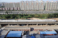 A CRH (China Railway High-speed) bullet train through  Beijing city..21 Sep 2009