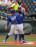 Mookie Betts and Rougned Odor joke on third base during a spring training game between the Texas Rangers and Los Angeles Dodgers in Surprise, Ariz., on Sunday, March 7, 2021.<br /> Photo by Cathleen Allison