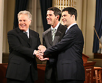Quebec City, March 13, 2007 - Jean Charest, Mario Dumont and Andre Boisclair shake hands before the debate at National Assembly March 13, 2007. Just two weeks before the March 26 election, the debate could be a turning point.<br /> <br /> PHOTO :  Francis Vachon - Agence Quebec Presse