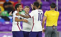 ORLANDO CITY, FL - JANUARY 31: Jesus Ferreira #9, Paul Arriola #7and Kellyn Acosta #10 of the United States celebrate a Jesus Ferreira goal during a game between Trinidad and Tobago and USMNT at Exploria stadium on January 31, 2021 in Orlando City, Florida.